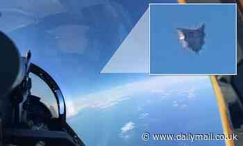 Leaked photo from Pentagon UFO task force shows silver cube hovering over the Atlantic