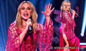 Kylie Minogue, 52, puts on a leggy display in fuchsia thigh-split gown with quirky mesh cape