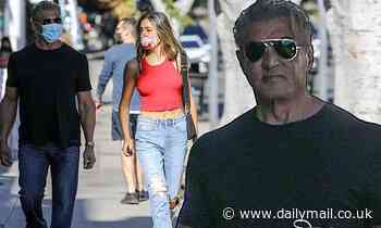 Sylvester Stallone, 71, relaxed in t-shirt and jeans as he runs errands with daughter Sistine, 22,