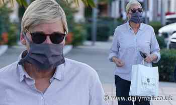 Ellen DeGeneres is casual in blue shirt and black pants as she runs errands in exclusive Montecito