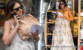 Jesinta Franklin shows off her growing baby bump as she visits a local bakery in Sydney