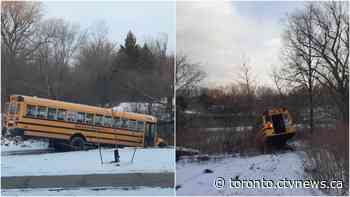 Police investigating after two school buses stolen, driven into ponds in Vaughan, Ont.