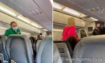 Frontier Airlines passengers applaud after woman who refused to wear mask removed from plane