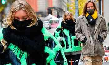 Elsa Hosk bundles up her bump in VERY eye-catching neon coat