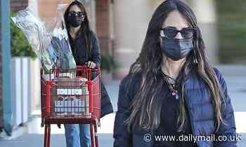 Jordana Brewster pairs a black winter jacket with jeans for grocery run in Santa Monica