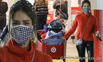 Jessica Alba dons holiday colors as she shops at Target and grabs a product from her Honest company
