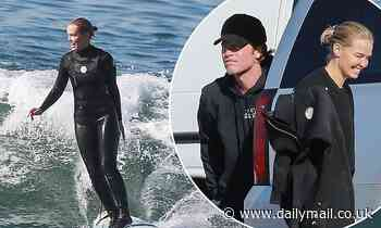 Lara Bingle shows off her figure in a wetsuit as she goes surfing with husband Sam Worthington