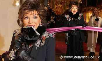 Joan Collins cuts a glamorous figure in a velvet face mask at Burlington Arcade's Christmas Lights