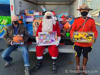 Empty Stocking Fund: Richmond citizens Stuff the Police Cruiser with thousands of toys
