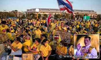Thousands of supporters greet Thailand's monarch as he leads birthday celebrations for late father