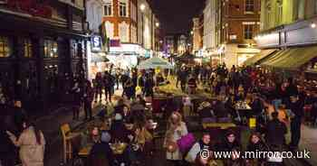 Thousands wrap up warm in Soho for Tier 2 drinks outside pubs and bars