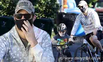 Chris Pratt goes for a bike ride with his son Jack after being dubbed a 'clown' on Twitter