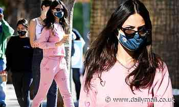 Eiza Gonzalez looks cute in a pink heart-adorned sweatsuit as she picks up a coffee in Los Angeles
