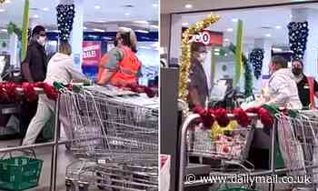 Terrifying moment frenzied Woolworths customer screams at staff and security
