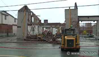 Clean up continues after wall of building collapses on Dundurn St. - CHCH News