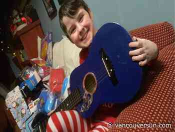 Richmond boy receives Christmas guitar seven years after dad died