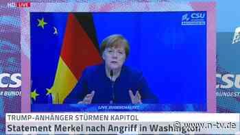 """""""Wütend und traurig"""": Merkel macht Trump für Sturm auf Kapitol verantwortlich"""