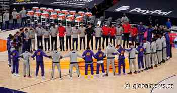 Toronto Raptors, Suns link arms in solidarity hours after storming of U.S. Capitol