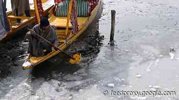 Dal lake freezes over in Kashmir due to cold snap