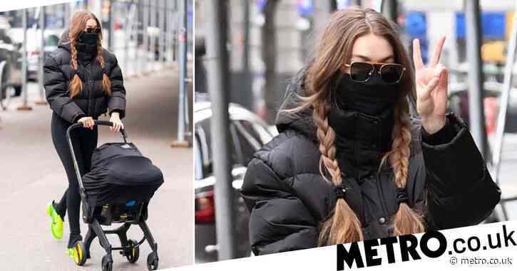 Gigi Hadid still manages to look high fashion as she wraps up for stroll with baby daughter in New York