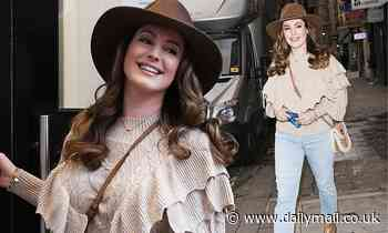 Kelly Brook looks chic in a wide-brimmed hat and ruffled jumper as she arrives at Heart Radio