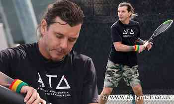 Gavin Rossdale works up a sweat in camouflage shorts as he plays tennis