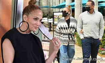 Jennifer Lopez wears wide-leg jeans and wrap sweater on Miami outing with Alex Rodriguez