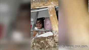Woman who is trapped underneath earthquake's rubble captured on video
