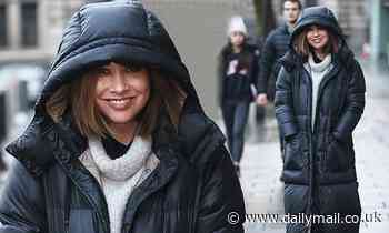 Myleene Klass wraps up in a cosy padded coat as she heads to work at Smooth Radio