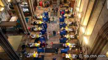 Covid-19 vaccines are given with organ music at UK's historic Salisbury Cathedral