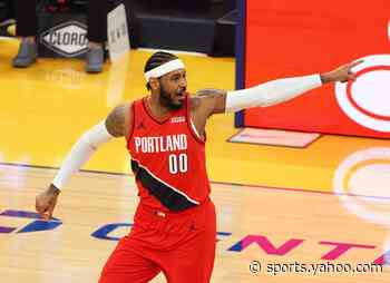 Steph Curry reacts to Carmelo Anthony's crafty footwork during Trail Blazers vs. Hawks
