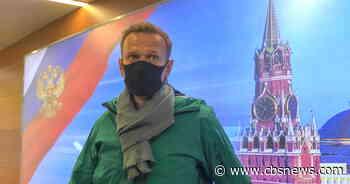 Putin foe Alexey Navalny detained as he returns to Moscow