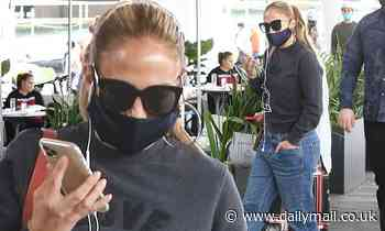Jennifer Lopez dons faux-nytail for lunch in Miami... ahead of presidential inauguration performance