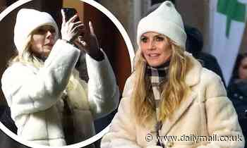 Heidi Klum wraps up in fluffy coat as she continues to shoot Germany's Next Top Model in Berlin
