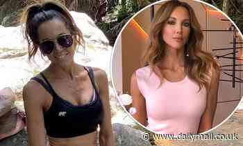 Kyly Clarke flaunts her toned torso in a crop top as she explores the great outdoors
