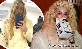 Ellie Goulding sports voluminous curls and a white feathered jacket in striking new snap
