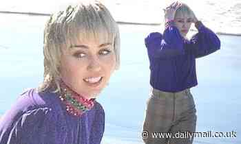 Miley Cyrus keeps her clothes ON for a change as she models winter fashion