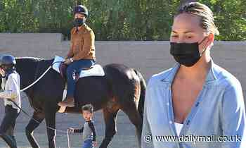 Chrissy Teigen and John Legend are hot to trot while horseback riding with kids Luna and Miles