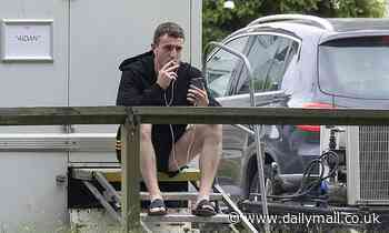 Paul Mescal changes into Gaelic football shorts for a smoke break between scenes on set of Carmen