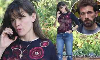 Jennifer Garner wears look of worry as she takes call.. amid Ben Affleck's split from Ana de Armas