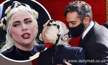Lady Gaga is seen KISSING tech entrepreneur Michael Polansky through MASKS
