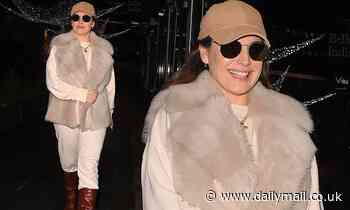 Kelly Brook wears a cream ensemble with faux fur gilet as she exits her radio hosting gig