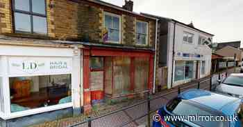 Inside eerie abandoned shop with food in cupboards and letters on the floor