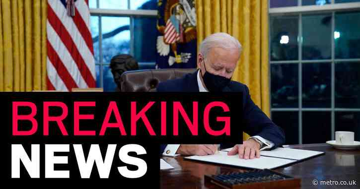 Joe Biden begins signing executive orders making masks compulsory and scrapping 'Muslim ban'