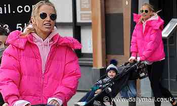Vogue Williams keeps it casual in a bold fuchsia padded coat