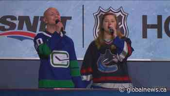 Frontline workers sing national anthem at Canucks home opener