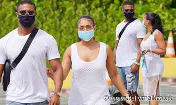 Lori Harvey holds the arm of her boyfriend Michael B Jordan as they take in a St Barts port