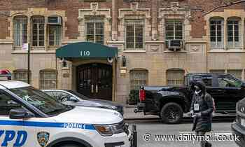 Doctor is taken into custody after his wife is found strangled to death at their Manhattan home