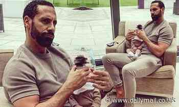 Rio Ferdinand and his newborn son Cree sport matching taupe tracksuits
