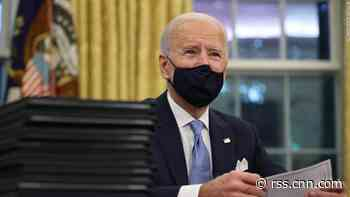Biden signs orders to get checks and food aid to low-income Americans, plus a federal pay raise